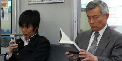 Asian father and son riding train