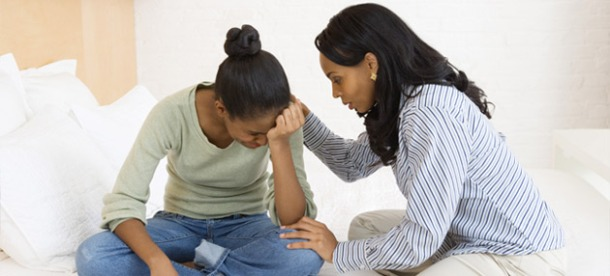 Woman consoling teenage girl