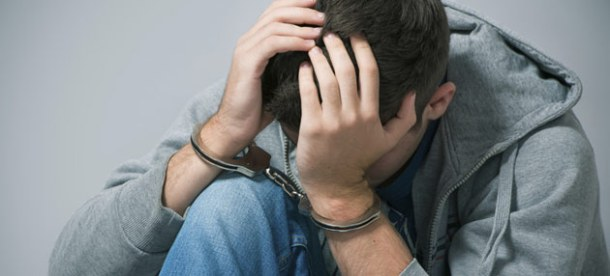 Teenage boy in handcuffs