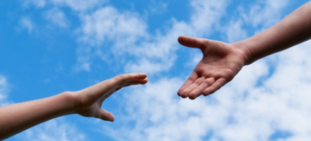 Outstretched hands reaching for help