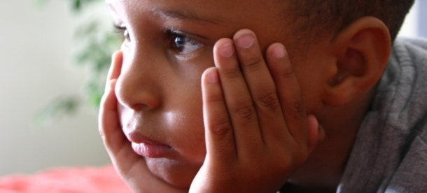 Sad African American boy
