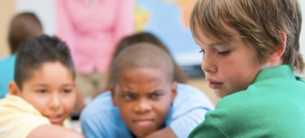 Boy being taunted by classmates