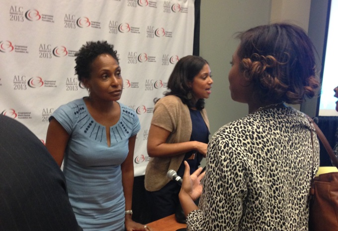 Dr. Bowleg talks with an attendee at the 2013 Congressional Black Caucus Legislative Conference