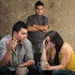Frustrated Latino parents with sullen teenage son