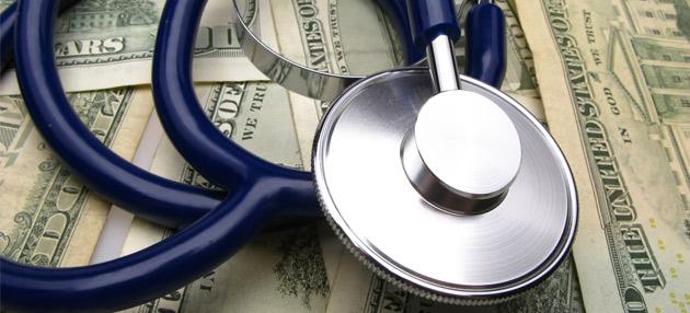 Stethoscope on pile of money