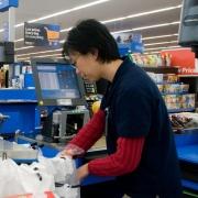 Cashier bagging groceries