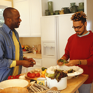 Gay couple preparing dinner together