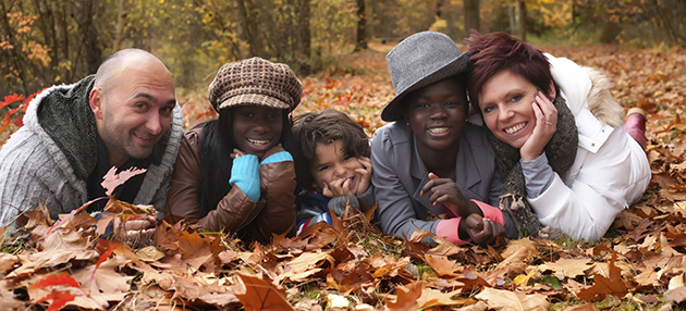 Adopted, multi-race family enjoying an autumn day