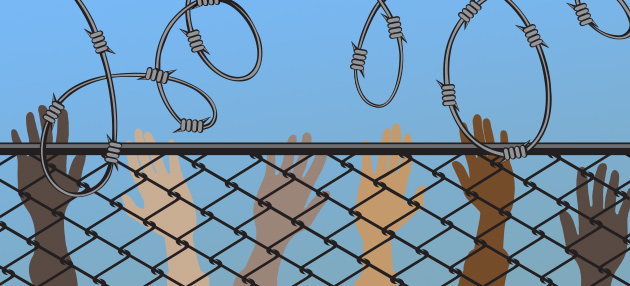Hands of different colors behind bars