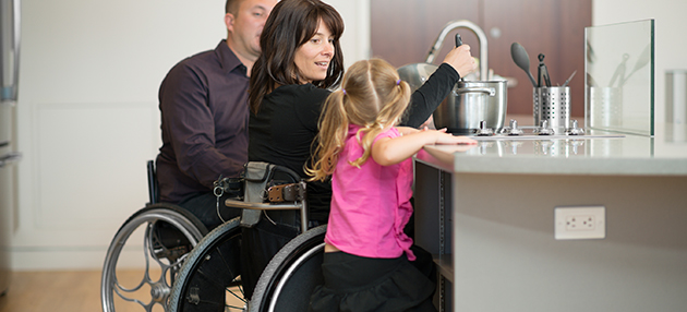Disabled couple making dinner with their daughter