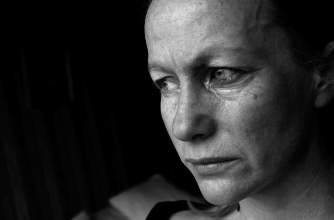 Black and white image of distraught woman