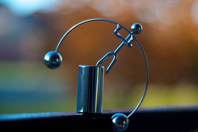 Balancing executive toy thrown off balance