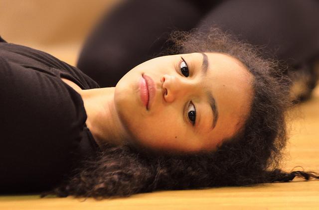 Young biracial girl staring into camera
