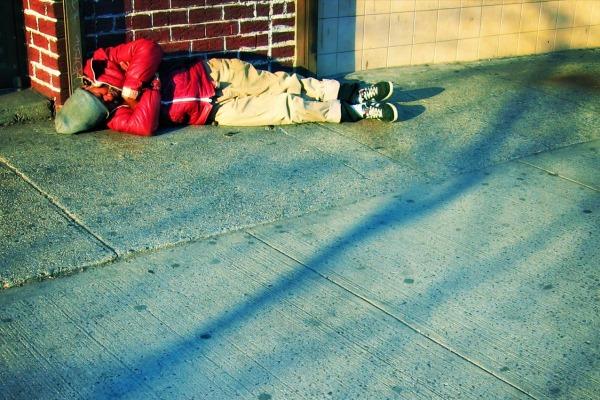 Homeless man sleeps on the street in NYC
