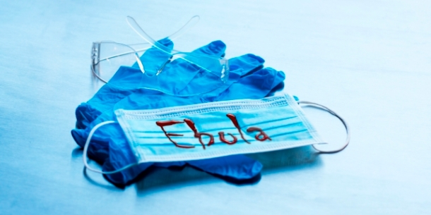 Latex gloves and medical mask with Ebola sign
