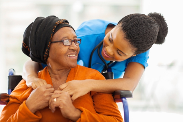 Senior African American patient with female nurse