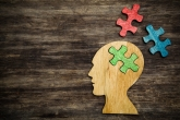 man head silhouette with jigsaw puzzle peace