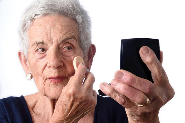 Senior woman make-up face on white background